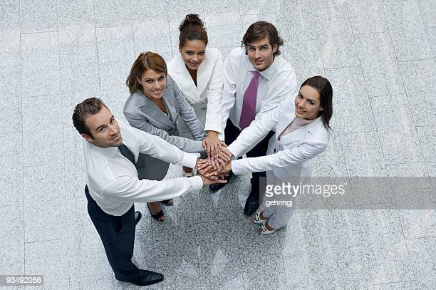 Top view of business people looking upwards