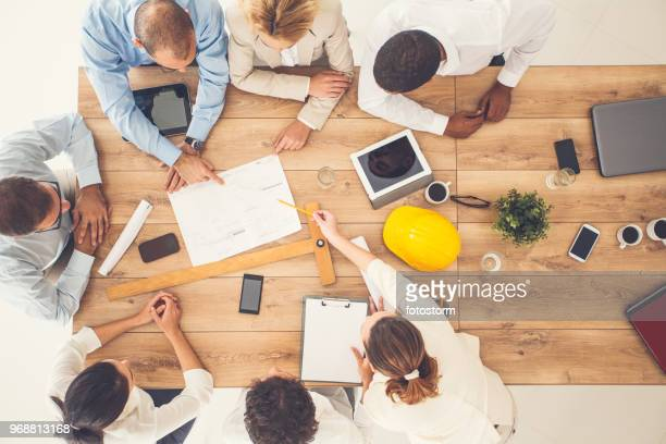 top view of business people on a meeting - design studio stock pictures, royalty-free photos & images