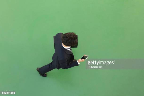 Top view of Businessman holding cell phone