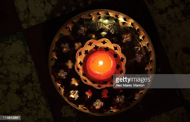 Top view of candle in bronze bowl