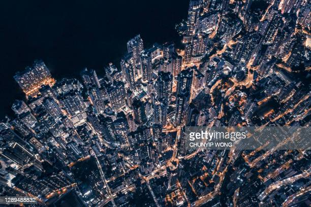 top view of central district in hong kong china at night - urban sprawl stock pictures, royalty-free photos & images