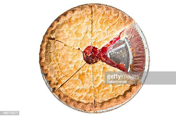 Top view of cherry pie with one slice missing