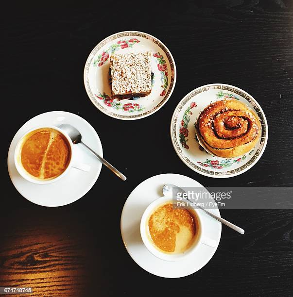 Top View Of Coffee And Sweet Food On Wooden Table