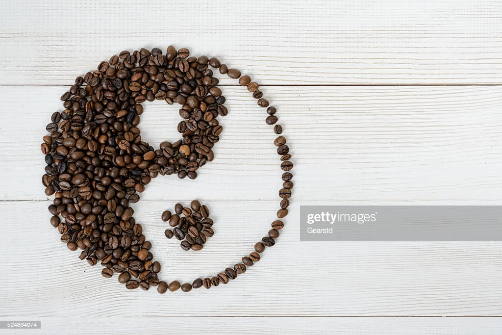 Top View Of Coffee Beans Making A Symbol Yin Yang Stock Photo