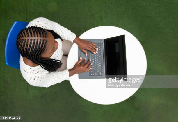 top view of confident black media professional using a laptop - showus stock pictures, royalty-free photos & images