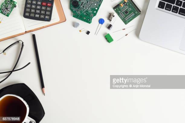 Top View of Electronic Engineer at Working Desk with Laptop, Electronic Components, Circuit Board