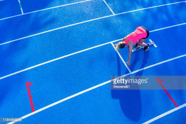 top view of female runner in starting position - sprint stock pictures, royalty-free photos & images