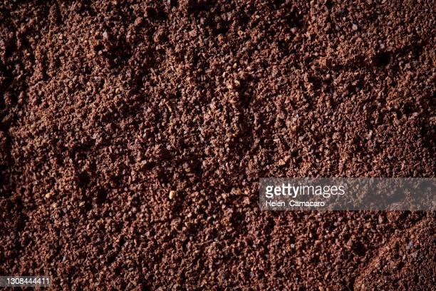 top view of fertile garden soil. background texture - boden stock-fotos und bilder