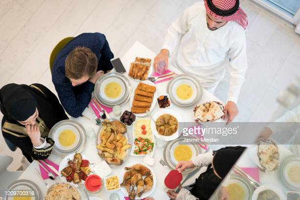 top view of food table of friends - iftar stock pictures, royalty-free photos & images