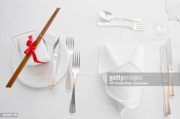 Top view of formal table setting with asian box.
