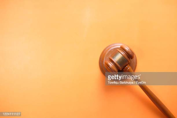 top view of gavel on orange background with copy space . - legal trial stock pictures, royalty-free photos & images