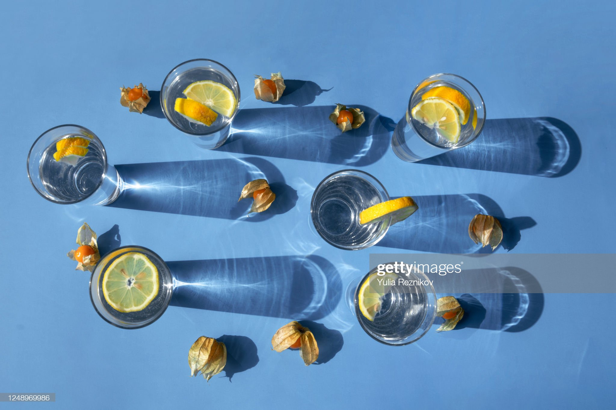 Top view of glasses with lemon on the blue background : Stock Photo