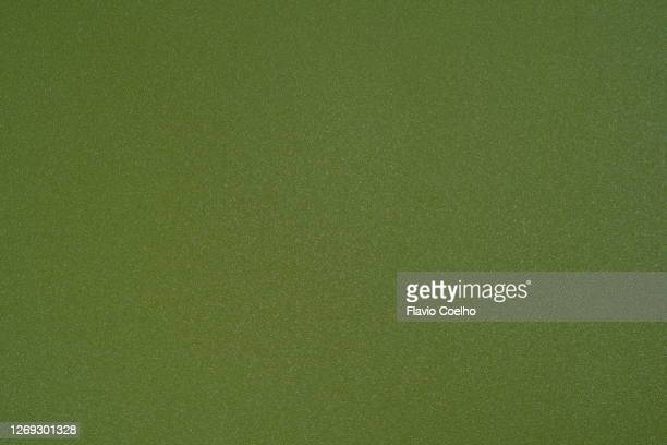 top view of green plastic surface background texture - spotted stock pictures, royalty-free photos & images
