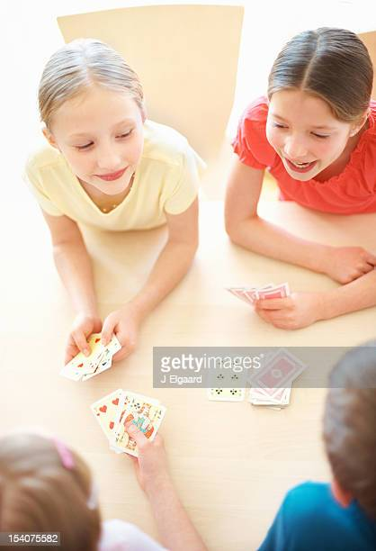Top view of happy children playing a card game