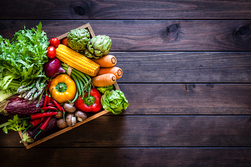 Top view of healthy vegetables in a wooden crate 973318654