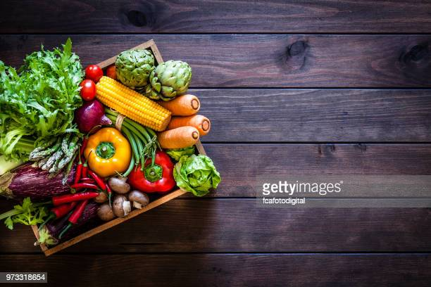 top view of healthy vegetables in a wooden crate - freshness stock pictures, royalty-free photos & images
