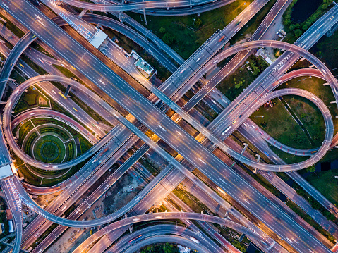 Top view of Highway road junctions at night. The Intersecting freeway road overpass the eastern outer ring road of Bangkok, Thailand. 965962418
