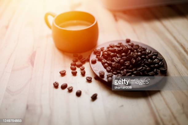 top view of hot coffee with roasted coffee bean on wooden table - ethiopia stock pictures, royalty-free photos & images