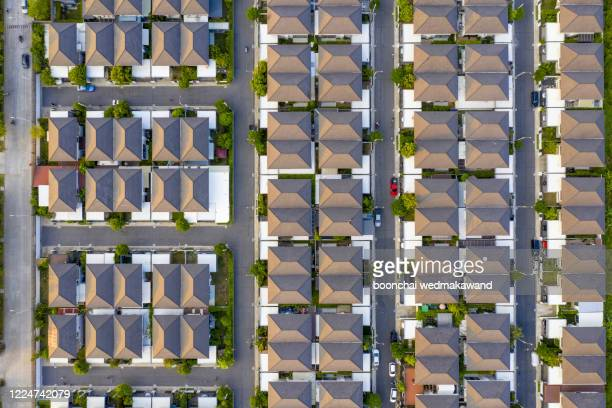 top view of house village from drone capture in the air house is darken roof top - drone point of view stock pictures, royalty-free photos & images