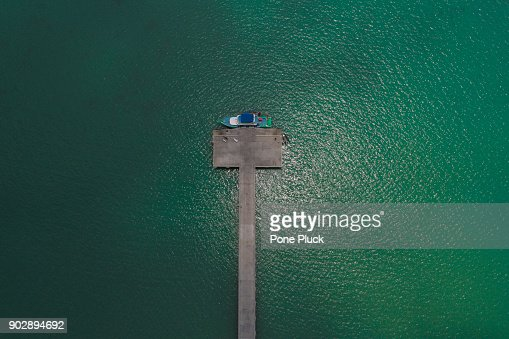 Top view of jetty over clear blue sea water