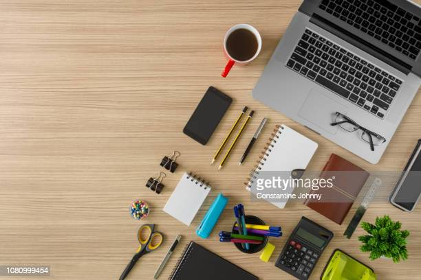 top view of laptop, notebook, coffee and office supply items on wood background - neat stock pictures, royalty-free photos & images