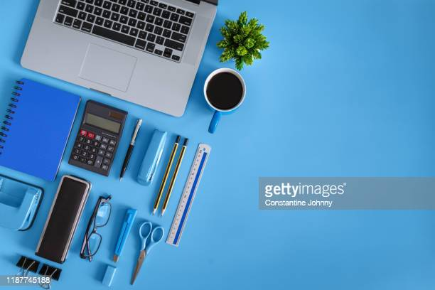 top view of laptop, notebook, coffee and office supply items - neat stock pictures, royalty-free photos & images
