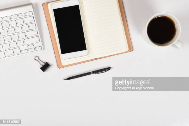 top view of laptop with computer keyboard and smart phone on white table - website template stock photos and pictures