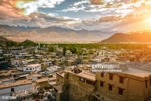Top view of Leh Ladakh city landscape with green tree, snow mountain and blue sky as background, Leh Ladakh - India