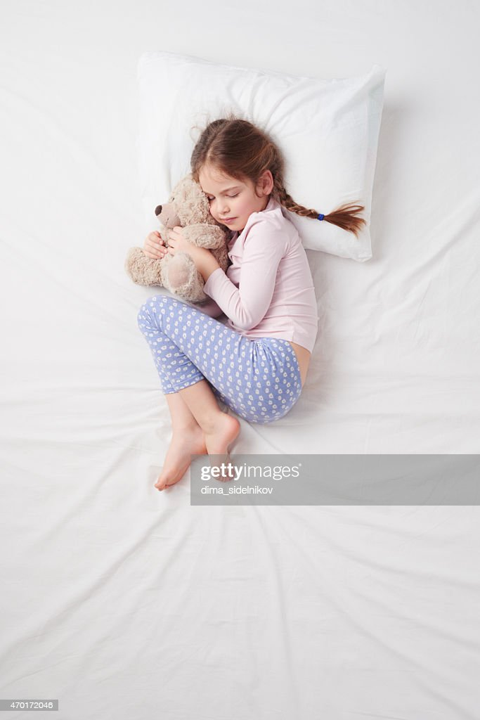 8e6223a0bc6a Top View Of Little Cute Girl Sleeping With Teddy Bear Stock Photo ...