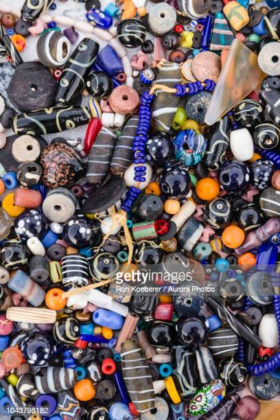 top view of lots of miscellaneous beads - koeberer stock photos and pictures
