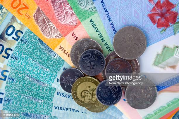 top view of malaysian bank notes and coins. - malaysian ringgit stock photos and pictures