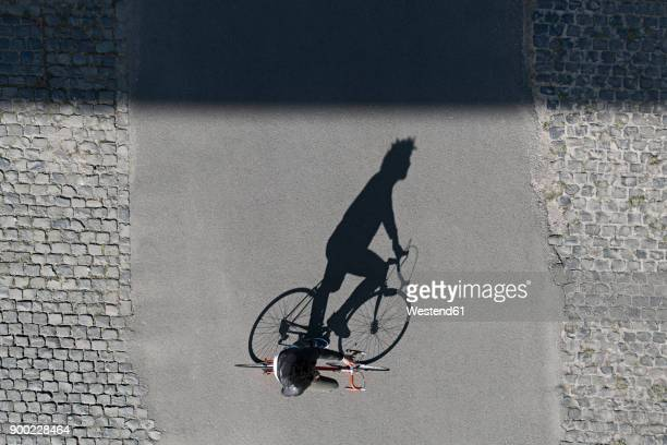 Top view of man riding bicycle