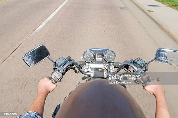 Top view of man riding motorcycle