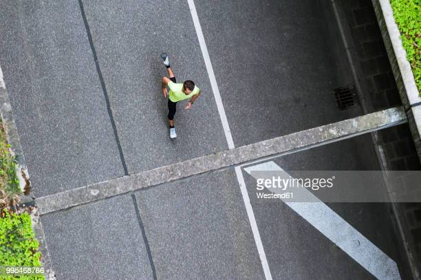 top view of man running on a street - men's track stock pictures, royalty-free photos & images