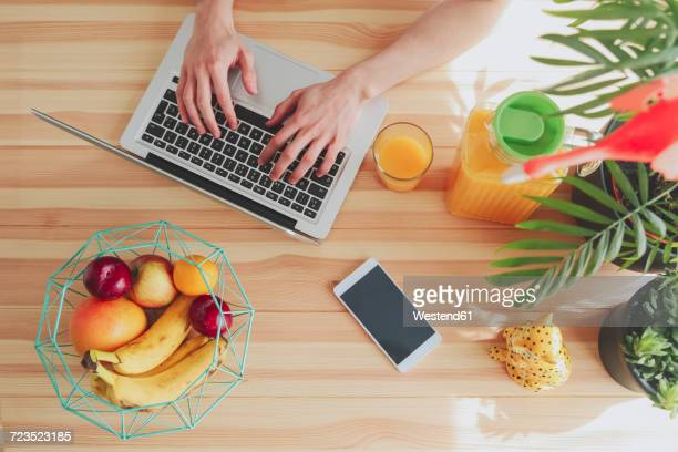 Top view of man using laptop at home