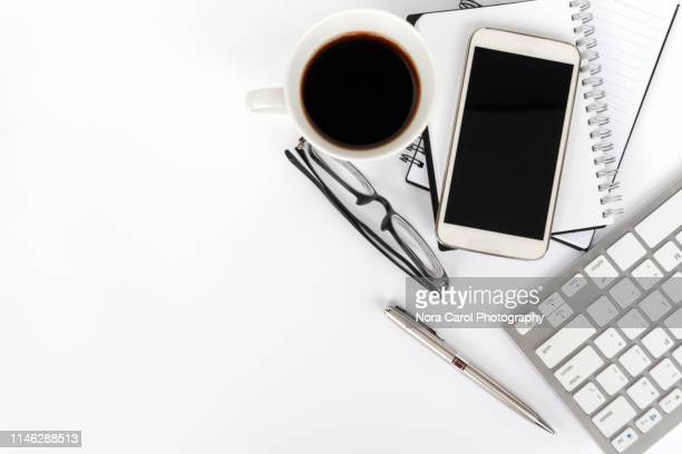 top view of office desk on white background - good condition stock pictures, royalty-free photos & images