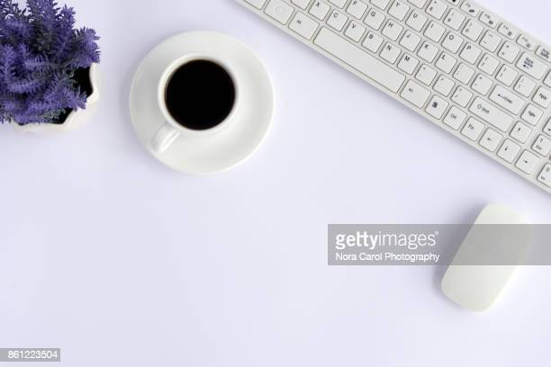 Top View of Office Desk With Coffee, Mouse and Slim Keyboard