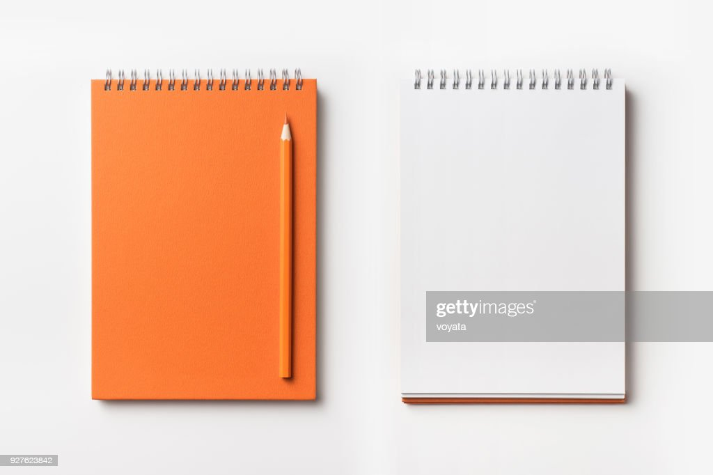 Top view of orange spiral notebook and color pencil collection : Stock Photo