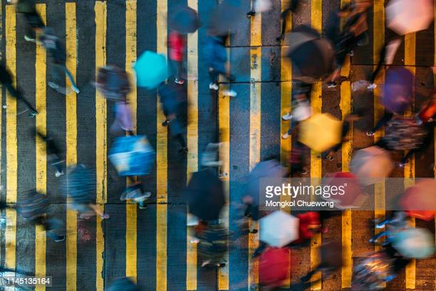 top view of people crossing a very busy crossroads at mong kok district hong kong in china - アクションショット ストックフォトと画像
