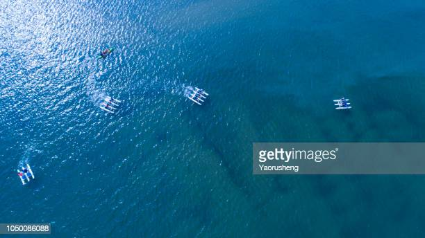 top view of people enjoying the peddle boating amusement on the sea in a sunny day,ningbo,china - ningbo stock pictures, royalty-free photos & images