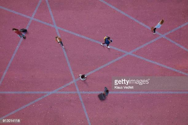 top view of people walking around on paths, on painted asphalt - social distancing stock-fotos und bilder