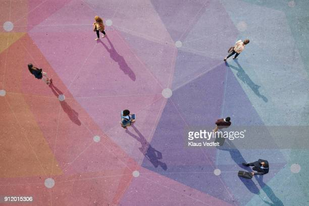 top view of people walking in different directions of pattern, painted on asphalt - distancia social fotografías e imágenes de stock