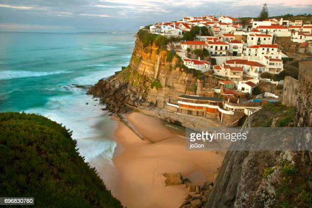 Top view of perched village of Azenhas do Mar surrounded by Atlantic Ocean