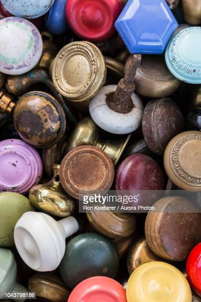 top view of pile of assorted colorful door knobs - koeberer stock photos and pictures