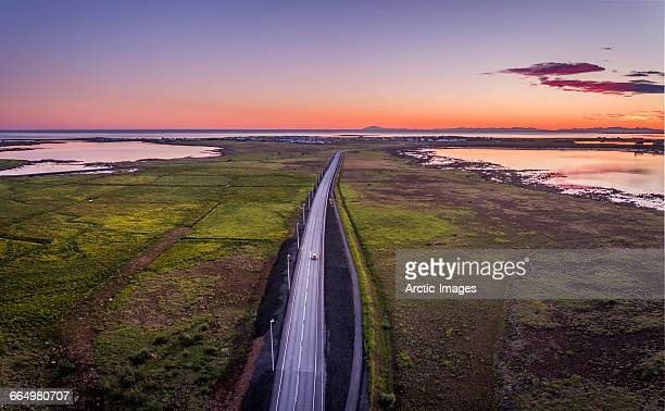 Top view of road and midnight sun, Iceland