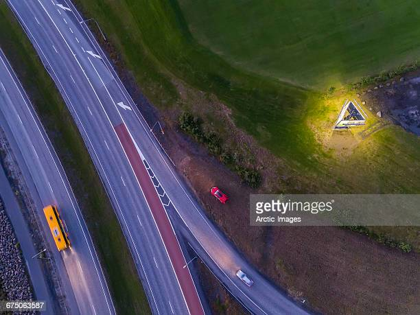 Top view of road with bus and car.