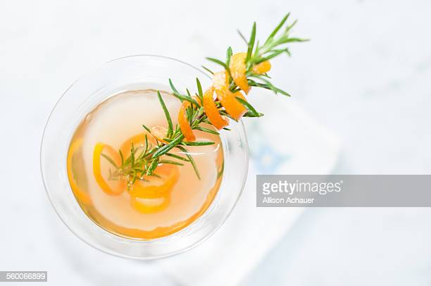 Top view of rosemary and kumquat cocktail