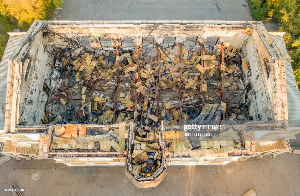 top view of ruined damaged destroyed building after war f : Stock Photo