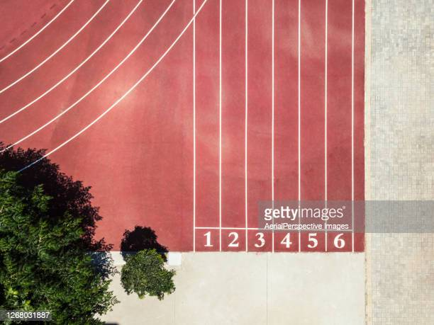 top view of running track with numbers - sports track stock pictures, royalty-free photos & images