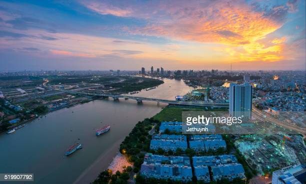 top view of saigon skyline around thu thiem bridge at colorful sunset - thiem stock pictures, royalty-free photos & images